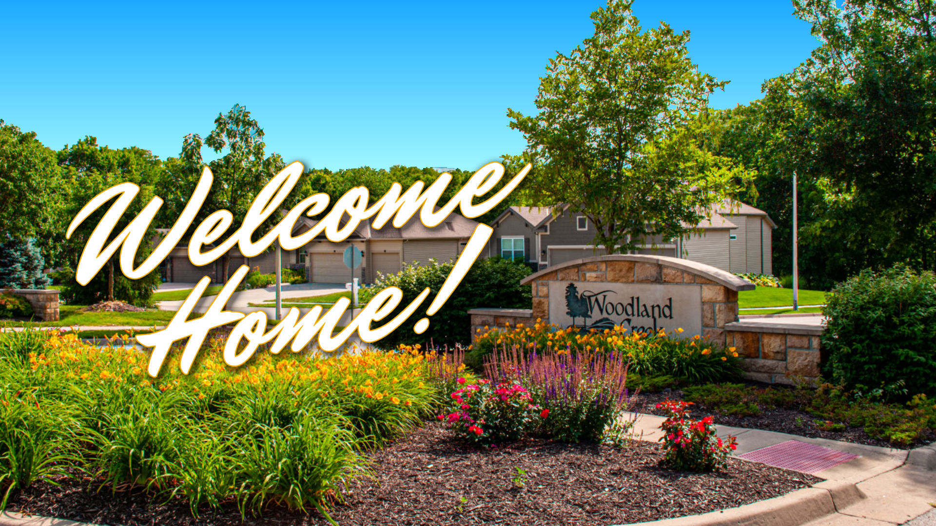 "Woodland Creek entrance sign with ""Welcome Home"" text added"